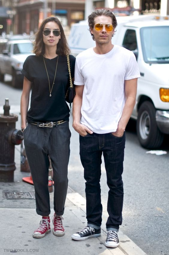 black jeans, a white t shirt and black converse