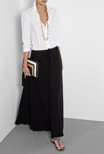 Chic look with black maxi skirt and classic white shirt
