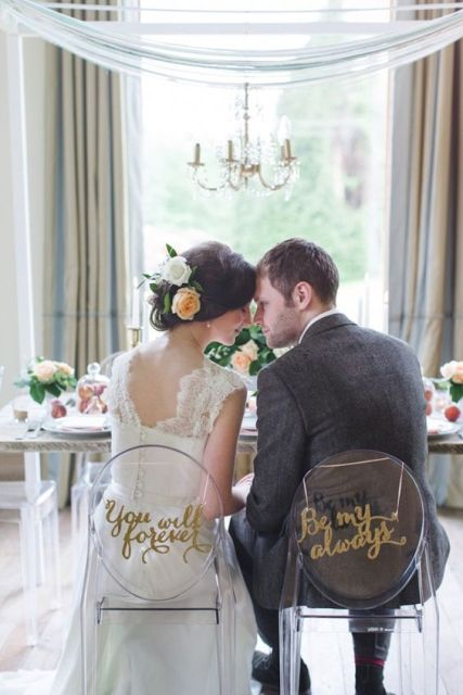 Bride's and groom's chairs with sweet words on them