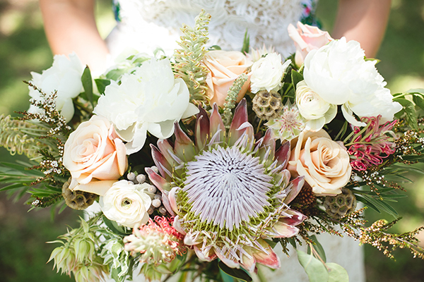 protea wedding bouquets - photo by Creatrix Photography http://ruffledblog.com/vibrant-bohemian-wedding-inspiration