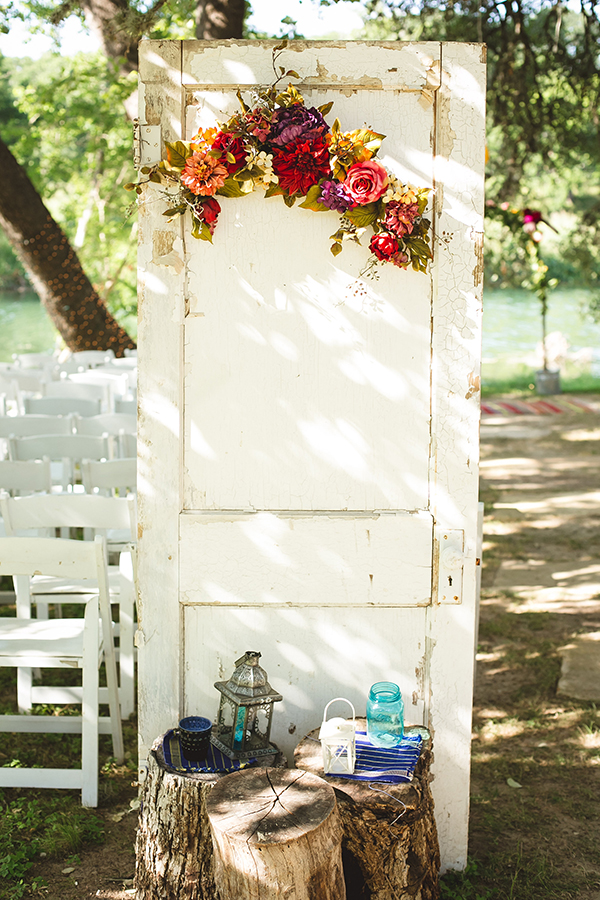 rustic wedding ceremony doors - photo by Creatrix Photography http://ruffledblog.com/vibrant-bohemian-wedding-inspiration