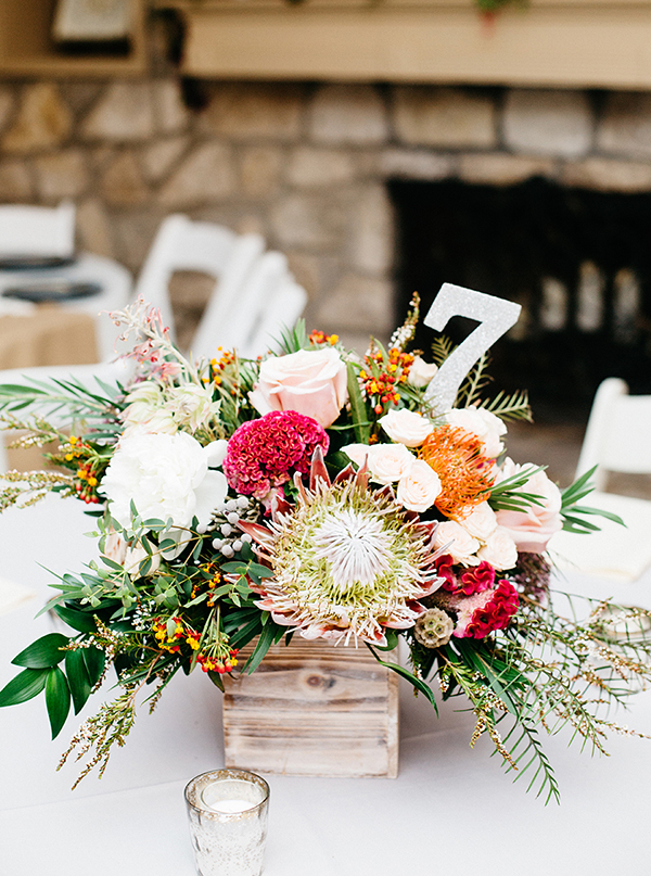 protea centerpices - photo by Veronica Ellerman Photography http://ruffledblog.com/vibrant-bohemian-wedding-inspiration