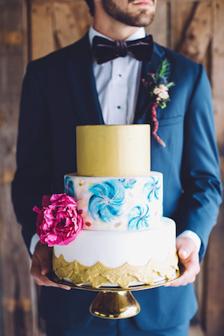 Gold and blue wedding cake with flower decor | Monika Gauthier Photography