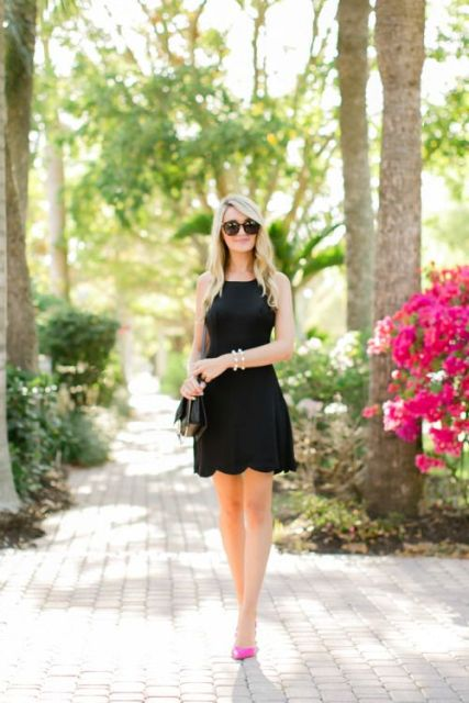 Black cocktail dress with pink pumps