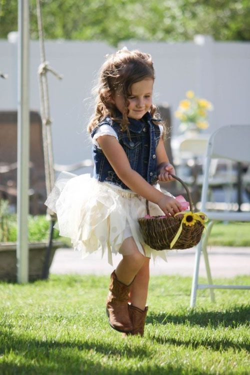 a white tutu dress, a denim vest and boots for a rustic fall wedding