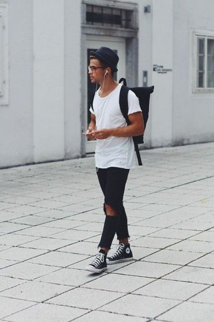 distressed black denim, a white tee and black sneakers