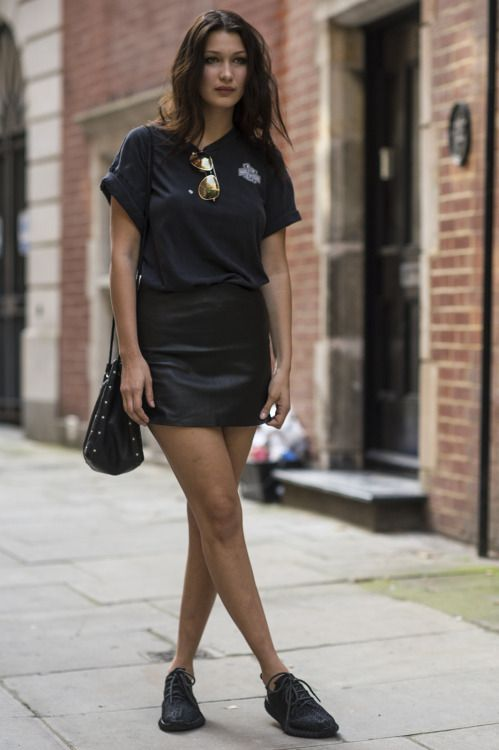 black leather mini, a black tee and sneakers