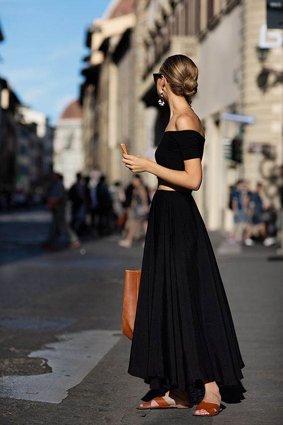 black off the shoulder crop top and a black pleated maxi