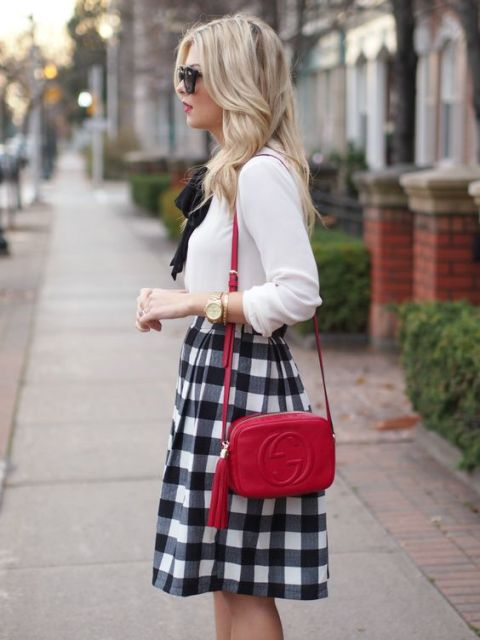 Stylish look with checked skirt, white blouse and red mini bag