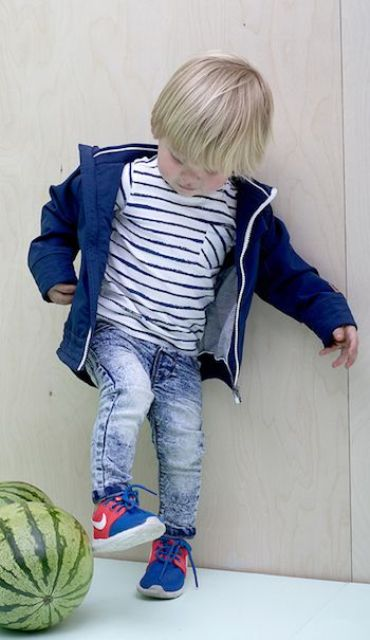 jeans, a striped shirt, a navy cardigan and blue chucks