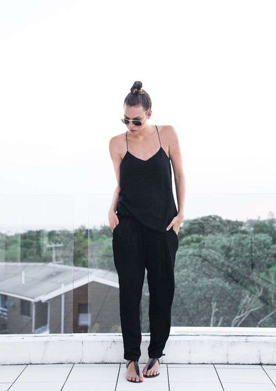 black pants, a black spaghetti strap top and sandals