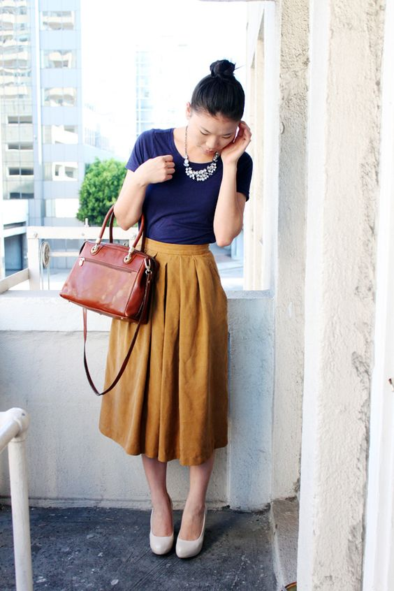 yellow midi, a navy tee, white shoes and a statement necklace