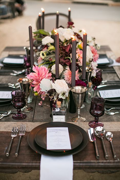 aubergine and blush wedding table setting with black dishes