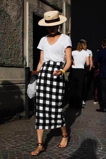 Checked midi skirt and straw hat
