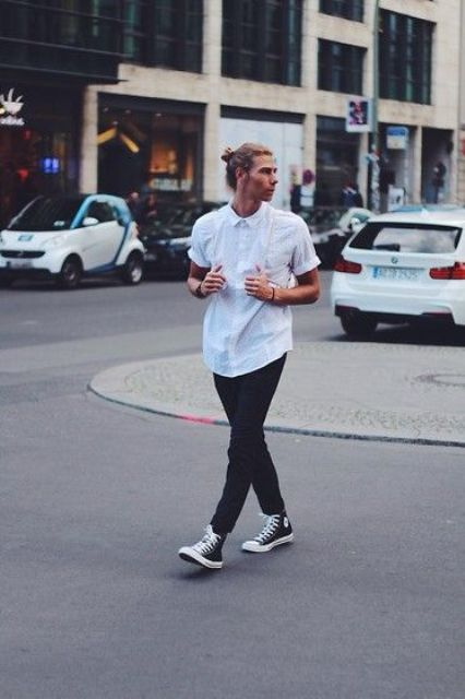 black jeans, a white shirt and black Converse high tops