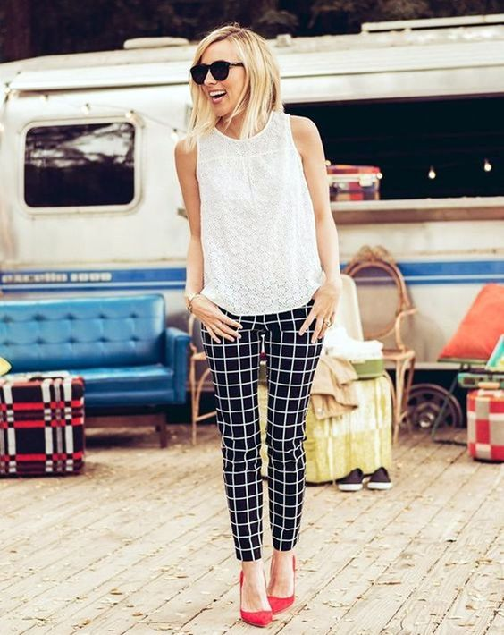 checked trousers, a white lace top and red heels