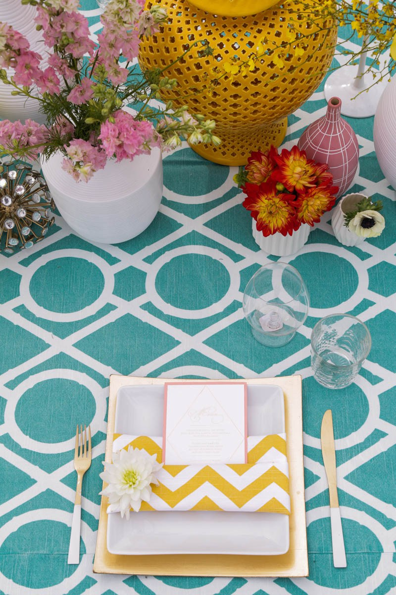 The tablescape blended turquoise and yellow in a harmonious way