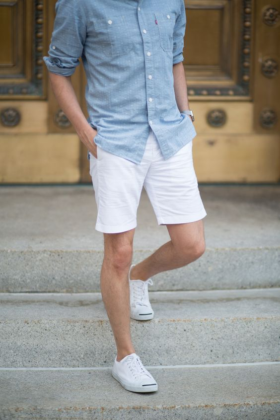 white denim shorts, a denim shirt and white sneakers