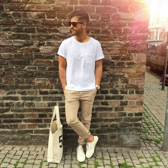 tan pants, a white tee and white Vans shoes