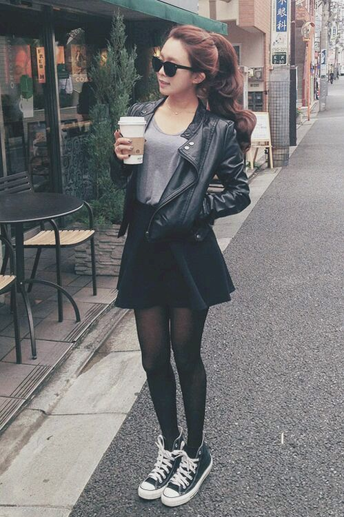 black skater skirt, a grey t-shirt, a black leather jacket and black Converse