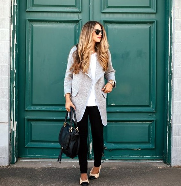 black jeans, a white top and a grey coat with flats