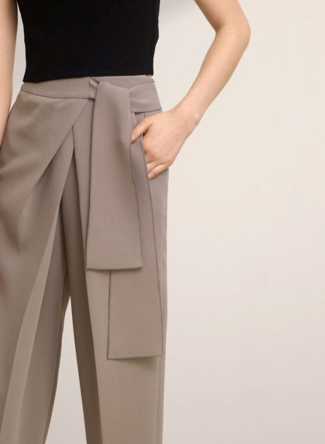 Stylish trousers with black shirt