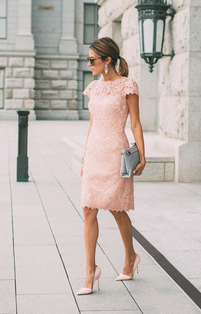 Outfit with lace dress, stylish pumps and clutch