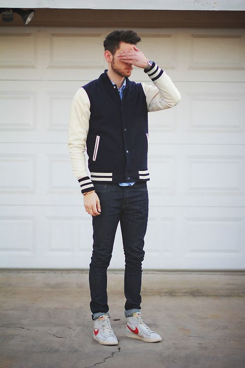 navy jeans, a navy and beige jacket and chucks