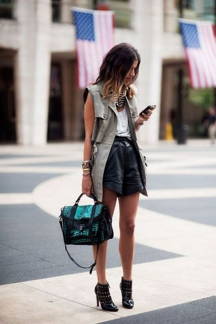 With white blouse, leather shorts and boots
