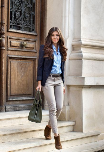 With blue shirt, gray pants and brown ankle boots