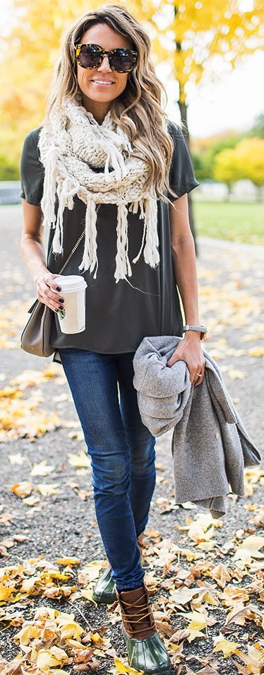 grey tee, blue jeans, a white fringe scarf