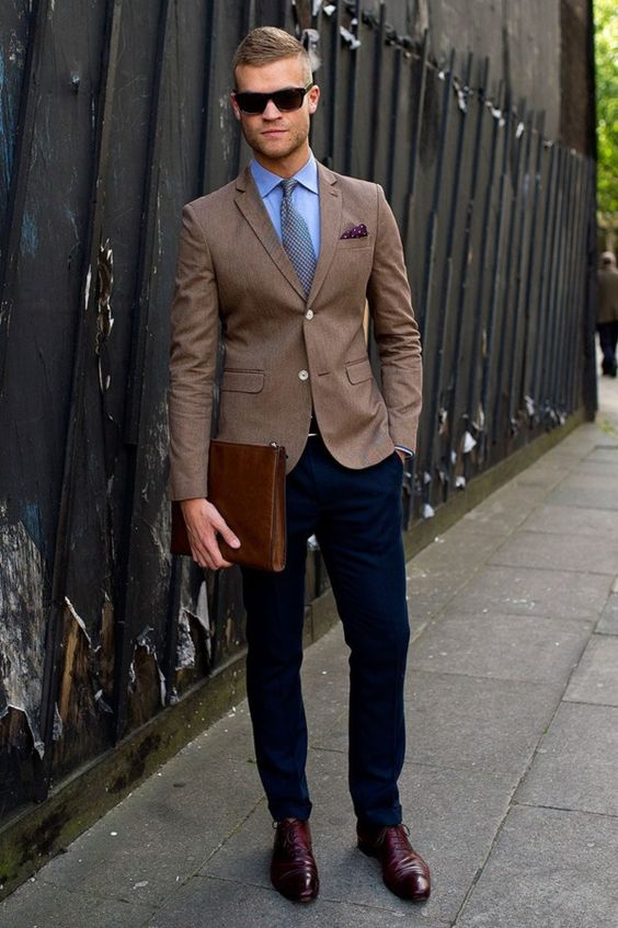 navy trousers, a brown blazer, a shirt and a tie, burgundy shoes