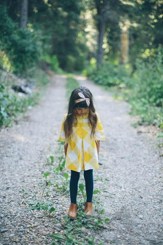 checked yellow dress, green leggings, brown boots