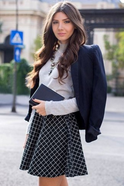 With gray shirt, printed skater skirt and statement necklace