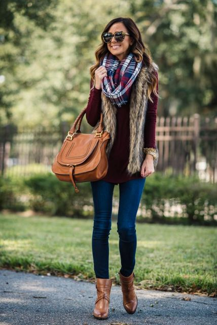 With plaid scarf, marsala shirt, fur vest and jeans