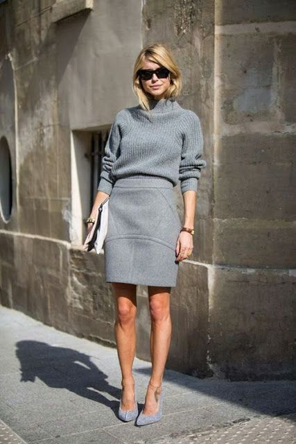 monochrome grey look with a skirt and a turtleneck sweater and heels