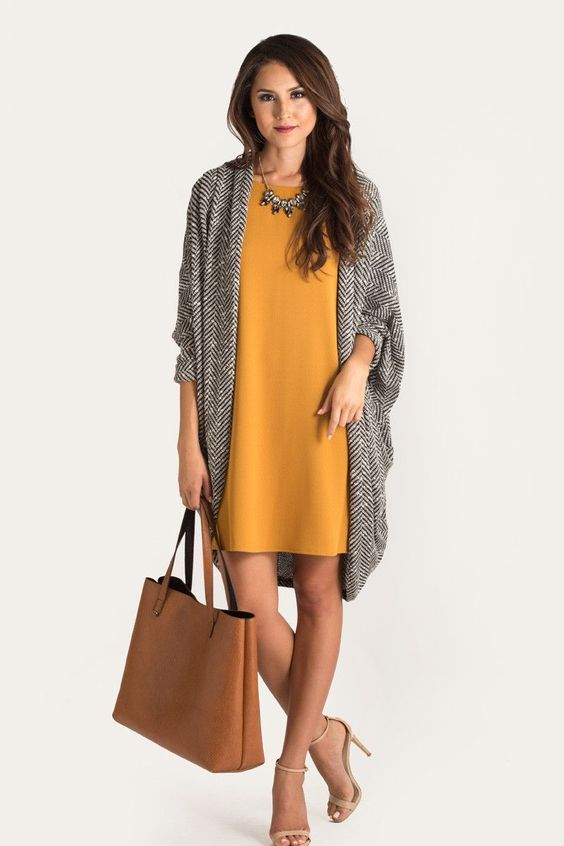 mustard dress, a chevron coat, a statement necklace and nude heels