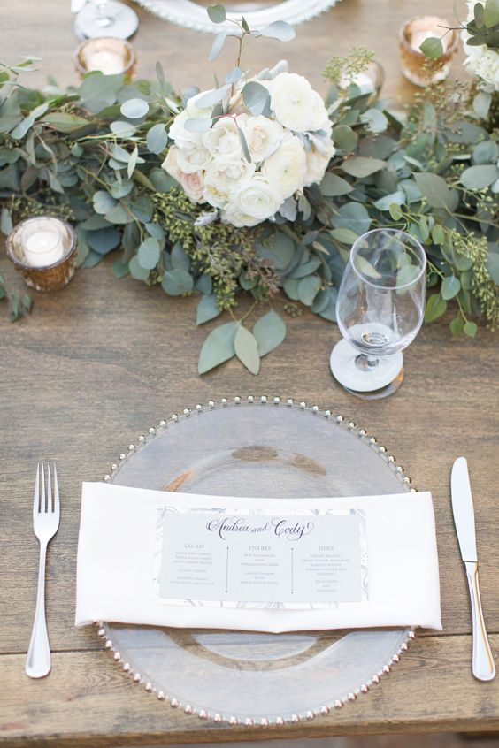 white and blush pink florals with eucalyptus leaves, long wooden tables with with greens and flowers for runners