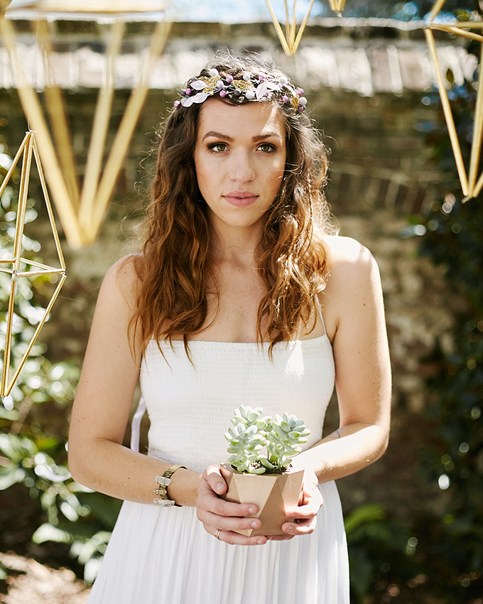 The bride rocked a beaded headpiece in the same colors as her bouquet
