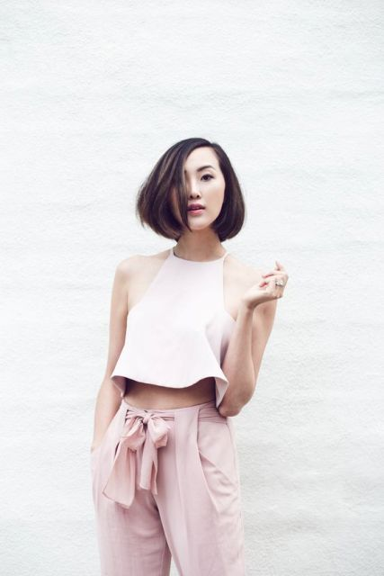 Light pink trousers with pastel crop top