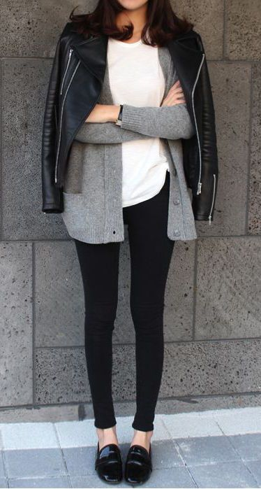 black leggings, a white tee, a grey cardigan and a black leather jacket