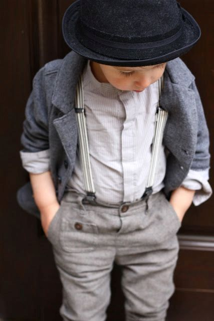 Rustic wedding outfit with warm jacket and black hat