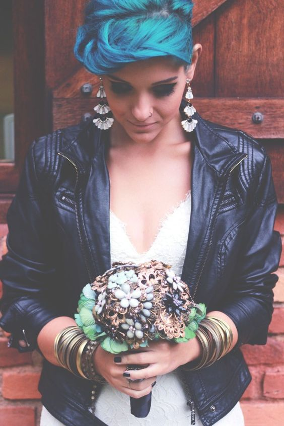 rock bride in a sweet white dress and a cropped leather jacket