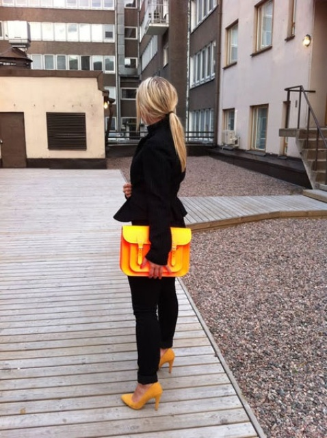 With black trousers and yellow bag and shoes