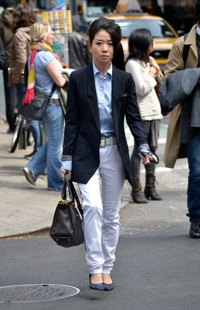 With blue shirt, white pants and pumps