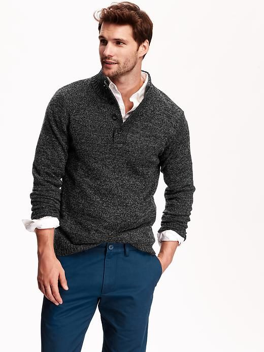 navy pants, a grey sweater and a white shirt