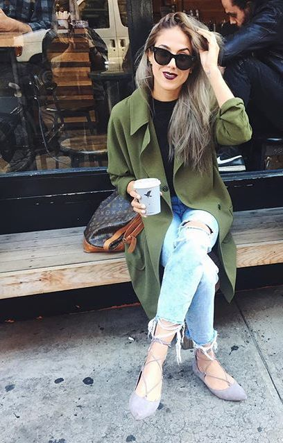distressed denim, a flowy green trench coat and grey lace up flats