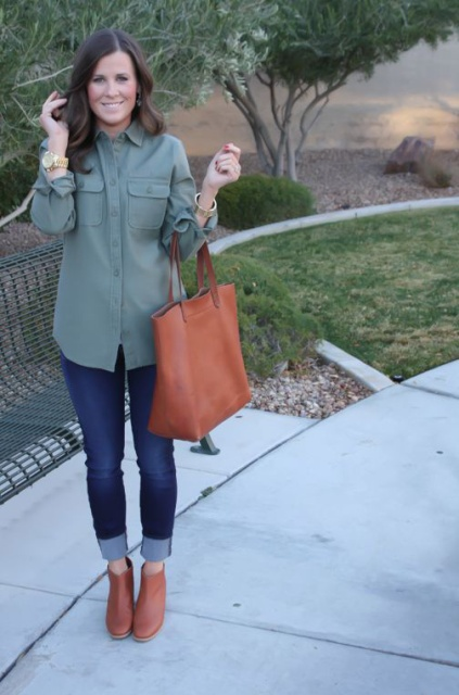 With green army shirt, cuffed jeans and tote bag
