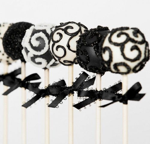 black and white pops with bows as favors