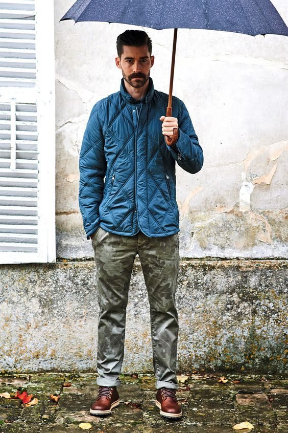a bright blue puffer jacket, camo trousers and cognac boots